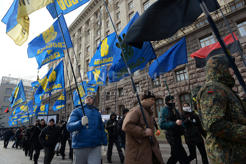 Protesters holding flags march in Kiev. Ukraine
