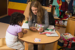 Education preschool 3-4 year olds SEIT working with child in classroom