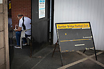 Bamber Bridge 1 Radcliffe 1, 07/09/2021. Sir Tom Finney Stadium, Northern Premier League Premier Division. A club official eating a snack inside the ground before Bamber Bridge take on Radcliffe in a Northern Premier League Premier Division fixture at the Sir Tom Finney Stadium, named after the late England international player who was born locally. Formed in 1952, Bamber Bridge, which is owned by a community organisation, merged with Walton-le-Dale FC in 1974 and moved to their current ground in 1983. The match against their opponents from Greater Manchester ended in a 1-1 draw, with Radcliffe missing a late penalty, watched by 393 spectators. Photo by Colin McPherson.