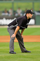 Umpire Ryan Clark handles the calls on the bases during the South Atlantic League game between the West Virginia Power and the Kannapolis Intimidators at Fieldcrest Cannon Stadium on April 21, 2011 in Kannapolis, North Carolina.   Photo by Brian Westerholt / Four Seam Images