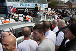 """© Joel Goodman - 07973 332324 . 28/08/2015 . Salford , UK . Paul Massey's coffin is carried on a horse drawn hearse from the church after the service . The funeral of Paul Massey at St Paul's CE Church in Salford . Massey , known as Salford's """" Mr Big """" , was shot dead at his home in Salford last month . Photo credit : Joel Goodman"""