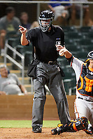 Home plate umpire Jordan Baker makes a call during an Arizona Fall League game between the Salt River Rafters and Mesa Solar Sox at Salt River Fields at Talking Stick on October 9, 2012 in Scottsdale, Arizona.  Salt River defeated Mesa 6-5.  (Mike Janes/Four Seam Images)