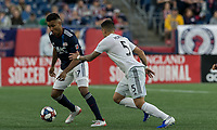 Foxborough, MA - May 25, 2019: Juan Agudelo (#17), Junior Moreno (#5) First half action. In a Major League Soccer (MLS) match, New England Revolution (blue/white) vs D.C. United (white), at Gillette Stadium on May 25, 2019 in Foxborough, MA. (Photo by Andrew Katsampes/ISI Photos).