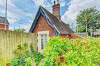 BNPS.co.uk (01202 558833)<br /> Pic: PropertyPublicity/BNPS<br /> <br /> Pictured: It's a Grade II listed cottage<br /> <br /> Loco-cation, loco-cation, loco-cation..<br /> <br /> This quirky property that is up for sale is all about its loco-cation - as it sits on a railway crossing right next to the train tracks.<br /> <br /> The Grade II listed cottage was built in 1850 to house the gatekeeper whose job it was to close the gates at the road crossing whenever a train was due.<br /> <br /> The gates, in the village of Stone, Staffs, were automated many years ago.