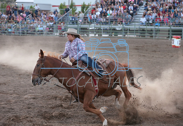 Carly Eller competes in the barrell racing event at the Smackdown Tour at Fuji Park in Carson City, Nev., on Saturday, June 7, 2014.<br /> Photo by Cathleen Allison
