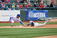 South Bend Cubs third baseman Christopher Morel (29) applies the tag to Gabe Snyder (24) on a stolen base attempt during a Midwest League game against the Cedar Rapids Kernels at Four Winds Field on May 8, 2019 in South Bend, Indiana. South Bend defeated Cedar Rapids 2-1. (Zachary Lucy/Four Seam Images)