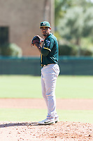 Oakland Athletics relief pitcher Leudeny Pineda (59) gets ready to deliver a pitch during an Instructional League game against the Los Angeles Dodgers at Camelback Ranch on September 27, 2018 in Glendale, Arizona. (Zachary Lucy/Four Seam Images)