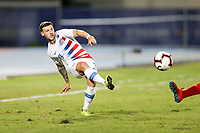 GEORGETOWN, GRAND CAYMAN, CAYMAN ISLANDS - NOVEMBER 19: Paul Arriola #7 of the United States passes off the ball during a game between Cuba and USMNT at Truman Bodden Sports Complex on November 19, 2019 in Georgetown, Grand Cayman.