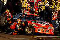 Nov 13, 2005; Phoenix, Ariz, USA;  Nascar Nextel Cup driver Jeff Gordon driver of the #24 Dupont Chevy makes a pit stop during the Checker Auto Parts 500 at Phoenix International Raceway. Mandatory Credit: Photo By Mark J. Rebilas