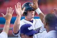 Tyler Kuhn #4 of the Winston-Salem Dash is congratulated by his teammates after scoring a run versus the Lynchburg Hillcats at Wake Forest Baseball Stadium August 29, 2009 in Winston-Salem, North Carolina. (Photo by Brian Westerholt / Four Seam Images)