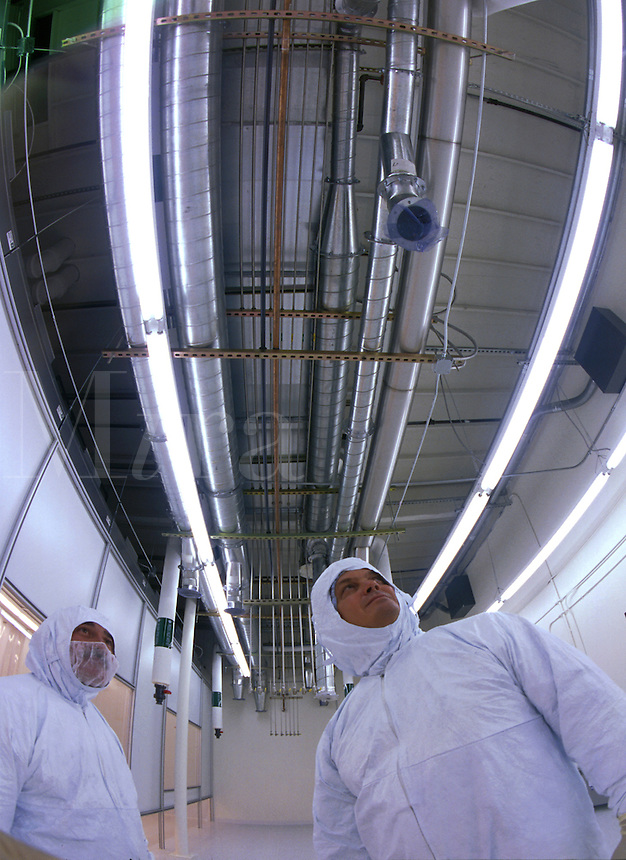 Technicians inspecting progress on ventilation for electronics 'clean' room. Arizona.