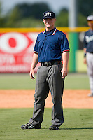 Umpire Guss Curtis handles the calls on the bases during an Appalachian League game between the Pulaski Mariners and the Burlington Royals at Burlington Athletic Park August 6, 2009 in Burlington, North Carolina. (Photo by Brian Westerholt / Four Seam Images)