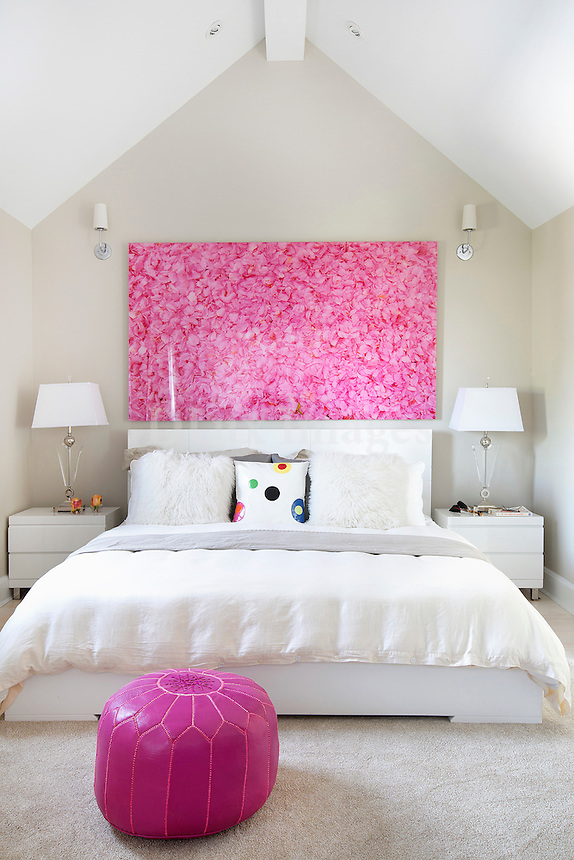 contemporary designed bedroom in white and pink