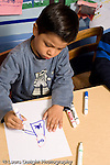 Education Preschool 4-5 year olds art activity boy drawing recognizable human figure with marker vertical