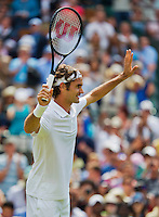 England, London, 24.06.2014. Tennis, Wimbledon, AELTC, Roger Federer (SUI) celebrates his victory over Lorenzi<br /> Photo: Tennisimages/Henk Koster