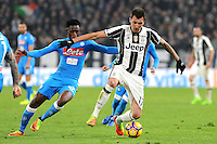 Calcio, semifinale di andata di Tim Cup: Juventus vs Napoli. Torino, Juventus Stadium, 28 febbraio 2017.<br /> Juventus' Mario Mandzukic, right, is challenged by Napoli's Amadou Diawara during the Italian Cup semifinal first leg football match between Juventus and Napoli at Turin's Juventus stadium, 28 February 2017.<br /> UPDATE IMAGES PRESS/Manuela Viganti