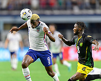 DALLAS, TX - JULY 25: Gyasi Zardes #9 of the United States heads the ball towards the Jamaica goal as Oniel Fisher #8 of Jamaica closes in during a game between Jamaica and USMNT at AT&T Stadium on July 25, 2021 in Dallas, Texas.