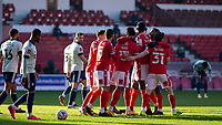 9th January 2021; City Ground, Nottinghamshire, Midlands, England; English FA Cup Football, Nottingham Forest versus Cardiff City; Lyle Taylor of Nottingham Forest celebrates with his team after scoring in the 3rd minute to take the lead 1-0