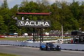 #10: Konica Minolta Acura ARX-05 Acura DPi, DPi: Ricky Taylor, Filipe Albuquerque crosses the finish line for the win under the checkered flag