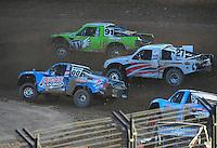 Dec. 10, 2011; Chandler, AZ, USA;  LOORRS pro 2 unlimited driver Robby Woods (99), Nick Tyree (91) and Scott Martenson (27) during round 15 at Firebird International Raceway. Mandatory Credit: Mark J. Rebilas-