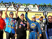 Jul. 31, 2011; Sonoma, CA, USA; (from left) NHRA pro stock motorcycle rider L.E. Tonglet , pro stock driver Greg Anderson , funny car driver Ron Capps and top fuel dragster winner Antron Brown in the winner's circle after winning the Fram Autolite Nationals at Infineon Raceway. Mandatory Credit: Mark J. Rebilas-