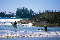 Long Beach, Pacific Rim National Park Reserve, Vancouver Island, BC, British Columbia, Canada - Surfers surfing with Pet Dog