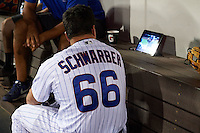 Mesa Solar Sox designated hitter Kyle Schwarber (66), of the Chicago Cubs, watches a tablet showing his teams MLB playoff game against the Los Angeles Dodgers during a game against the Salt River Rafters on October 22, 2016 at Sloan Park in Mesa, Arizona.  It was the first game action for Schwarber who was injured April 7th and underwent surgery to repair two ligament tears in his left knee.  Salt River defeated Mesa 7-2.  (Mike Janes/Four Seam Images)