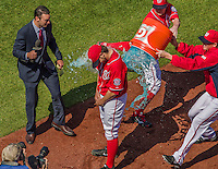 26 April 2014: Washington Nationals pitcher Tanner Roark is drenched by teammates after a win against the San Diego Padres at Nationals Park in Washington, DC. Roark pitched his first complete MLB game, a 3-hit shutout, as the Nationals defeated the Padres 4-0 to take the third game of their 4-game series. Mandatory Credit: Ed Wolfstein Photo *** RAW (NEF) Image File Available ***