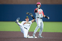 Michigan Wolverines shortstop Benjamin Sems (2) gets tangled up with  Ohio State Buckeyes Sam Wilson (33) after a steal attempt on April 9, 2021 in NCAA baseball action at Ray Fisher Stadium in Ann Arbor, Michigan. Ohio State beat the Wolverines 7-4. (Andrew Woolley/Four Seam Images)