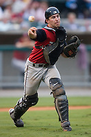 Carolina catcher Brett Hayes (12) fires the ball to first base versus Tennessee at Smokies Park in Sevierville, TN, Friday, July 27, 2007.