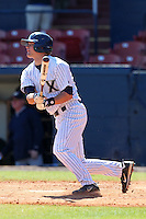 Xavier Musketeers John McCambridge #4 during a game vs. the Akron Zips at Chain of Lakes Park in Winter Haven, Florida;  March 11, 2011.  Xavier defeated Akron 7-0.  Photo By Mike Janes/Four Seam Images