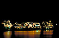 The uniquely and elaborately lighted houses and boat houses along the Schuylkill River reflect on the river. Philadelphia Pennsylvania United States Boathouse Row.