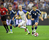 Houston, TX - Tuesday June 21, 2016: Michael Bradley, Ever Banega during a Copa America Centenario semifinal match between United States (USA) and Argentina (ARG) at NRG Stadium.