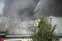 Friday 26 August 2016<br /> Emergency services attend fire at an industrial unit belonging to E.W.S. in Llandarcy, Neath & Port Talbot, Wales, UK.