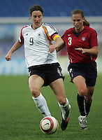 MAR 15, 2006: Faro, Portugal:  USWNT defender (3) Christie Rampone tries to catch up to German forward (9) Birgit Prinz in the finals of the Algarve Cup in Faro, Portugal.