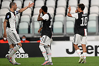 Paulo Dybala of Juventus (R) celebrates after scoring the goal of 1-0 with team mates Leonardo Bonucci and Douglas Costa during the Serie A football match between Juventus FC and US Lecce at Juventus stadium in Turin  ( Italy ), June 26th, 2020. Play resumes behind closed doors following the outbreak of the coronavirus disease. Photo Andrea Staccioli / Insidefoto