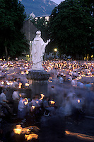 Evening outdoor religious ceremony, city of Lourdes, France.