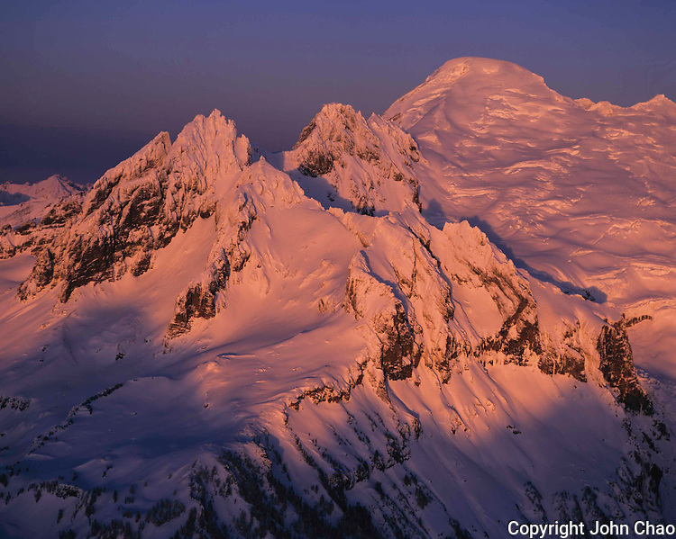 Aerial view of sunset lighting the Black Buttes of Mount Baker, North Cascades Mountain Range, Washington State