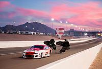 Oct 31, 2020; Las Vegas, Nevada, USA; NHRA pro mod driver Khalid ALbalooshi slows with his parachutes as the sun sets behind during qualifying for the NHRA Finals at The Strip at Las Vegas Motor Speedway. Mandatory Credit: Mark J. Rebilas-USA TODAY Sports