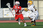 Baltimore, MD - March 3: Defensemen/long stick midfielder Ethan Murphy #13 of the UMBC Retrievers defends Attackmen Nick Guida #37 of the Fairfield Stags during the Fairfield v UMBC mens lacrosse game at UMBC Stadium on March 3, 2012 in Baltimore, MD.