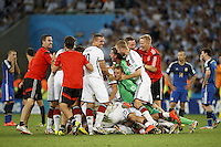 The Germany team celebrate at the final whistle
