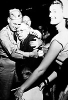 Repatriated POW Capt. Frederick Smith is greeted by his father on his arrival at Fort Mason, Calif., on board the USNS Marine Phoenix.  September 14, 1953.  Herb Weiss. (Army)<br /> NARA FILE #:  111-SC-431160<br /> WAR & CONFLICT BOOK #:  1521
