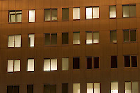 Windows in an Residential Building Illuminated at Night, in the DUMBO neighborhood of Brooklyn, New York City, USA