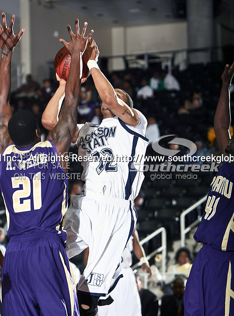 Jackson State Tigers forward Grant Maxey (32) and Prairie View A & M Panthers forward Michael Webb (21) in action during the SWAC Tournament game between the Prairie View A & M Panthers and the Jackson State Tigers at the Special Events Center in Garland, Texas. Jackson State defeats Prairie View A & M 50 to 38.