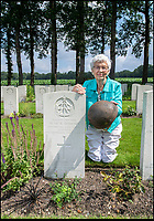 BNPS.co.uk (01202 558833)<br /> Pic: PhilYeomans/BNPS<br /> <br /> Willemein Rieken with the recently rediscovered helmet worn by Trooper Edmunds at his grave at Arnhem.<br /> <br /> As the 75th anniversary of Operation Market Garden begins tomorrow, one of the original 'flower girl''s of Arnhem is still remembering...<br /> <br /> A heartwarming tale of dedication and rememberance has been revealed over a remarkable Dutch pensioner who still tends the grave of a fallen British Arnhem hero, 75 years after he perished in battle.<br /> <br /> Every year, Willemien Rieken (84) still lays flowers at Oosterbeek War Cemetery in memory of Trooper William Edmond, who was shot by a German sniper in the early stages of Operation Market Garden in 1944.<br /> <br /> Trp Edmond, of the elite 1st Airborne Reconnaissance Squadron's final words, uttered to two comrades who came to his aid, were 'tell my wife I love her'.<br /> <br /> Willemien was just nine years old when Oosterbeek became a bloody battleground in September 1944. The retired director's secretary, now aged 84, hid in a small cellar underneath her father's confectionary shop for five days while fierce fighting raged around their house and garden.<br /> <br /> Twenty-five of her family, friends and neighbours packed into the confined space and cowered in fear in the deafening din of shooting and explosions.<br /> <br /> After the war the grateful citizens of Arnhem arranged a poignant ceremony involving a nine year old Willimein and other school children from the town, to lay flowers at the graves of the British soldiers killed in the battle. <br /> <br /> And the dedicated pensioner is now one of the last survivors to still undertake the task.