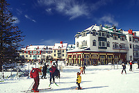 AJ0653, Canada, Quebec, People skiing at Tremblant Ski Resort at Mont Tremblant. The village has an Old Quebec City atmosphere.
