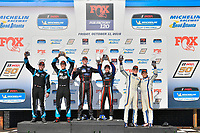 #69 Motorsports In Action McLaren GT4, GS: Jesse Lazare, Corey Fergus, #15 Multimatic Motorsports Ford Mustang GT4, GS: Austin Cindric, Sebastian Priaulx, #46 Team TGM Mercedes-AMG, GS: Owen Trinkler, Hugh Plumb celebrate on the podium with trophy