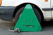 Wheel clamp on a car in Camden, London.
