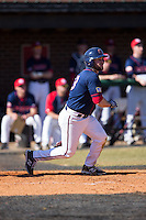 Jimmy Spanos (13) of the Shippensburg Raiders follows through on his swing against the Belmont Abbey Crusaders at Abbey Yard on February 8, 2015 in Belmont, North Carolina.  The Raiders defeated the Crusaders 14-0.  (Brian Westerholt/Four Seam Images)