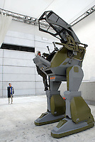 """The """"Land Walker"""", a human piloted walking robot developed by a Japanese company called Sakakibara Kikai. With the height of over 3m, and weight of 1000kgw, it only manages to travel at the speed of 1.5km/h."""